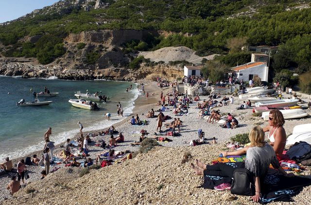 consequences rechauffement climatique people enjoy the warm autumn weather temperatures on a beach in the calanques national park near marseille 5474122